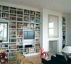 Bookshelves in an open plan living/dining area.