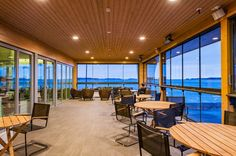Café Nokkalan Majakka, built with Honkarakenne's non-settling logs, represents ambitious and modern wood construction in maritime surroundings. Wood Construction, Lighthouse, Building, Modern, Table, Logs, Furniture, Commercial, Public