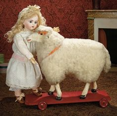 The Memory of All That - Marquis Antique Doll Auction: 105 Grand-Sized Early Paper Mache Glass-Eyed Lamb on Wooden Pull-Toy Platform