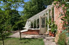 A lovely example of a mono-pitch greenhouse. You can reduce the pitch according to wall height - but the higher the better!