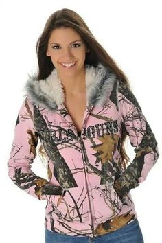 Mossy Oak Break Up Pink Fur Hoodie - Shell Material: 60% Cotton/40% Polyester fleece - Sherpa Lined Interior - Lined drawstring hood with soft faux fur trim - This items runs S. We suggest ordering on
