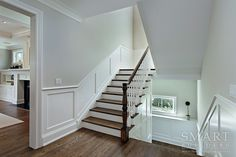 Stairway | Classic Chic Style Custom Home | Hardward Floors | Open Stairway | Wainscot Panels | Smart Builders, Inc.