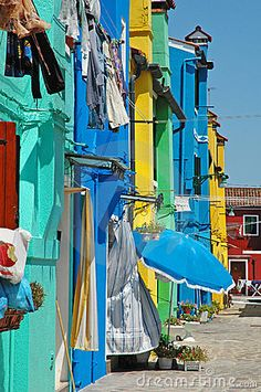 Row of colorful houses on the island of Burano, off of Venice....such a pretty and photogenic island.