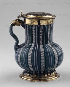 Glass tankard, Tudor, c1548. Blue and white twisted glass tankard. Although the technique of this tankard is of Venetian glass, the form is derived from contemporary northern European pottery, particularly of the type known as 'Malling' tankards, so it could have been made by a glassmaker from Murano (Venice) working in London.