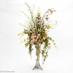 Cream and taupe floral arrangement on silver candlestick
