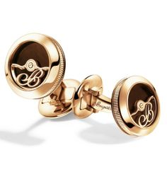"""9907.BR.EC  """"Oscillating weight"""" cufflinks Enhanced with Breguet's initial, an oscillating weight carved in pink gold rotates freely on the cufflinks' chocolate-brown enamel face. This undisguised homage to Breguet watch movements incorporates an actual ball bearing and features classic Breguet fluting on the rim. Available at Manfredi Jewels"""