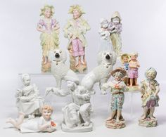 Lot 374: William Kent Staffordshire Poodle Figurines; Pair of William Kent Staffordshire poodle dogs with marks on the undersides; together with two French bisque seated figurines, two Capodimonte standing children figurines and five unmarked figurines
