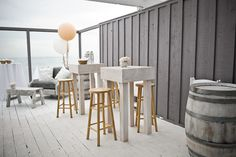 White Cocktail Tables, White Wine Barrels, Gray Chair, Blush Peachy Pink Flowers