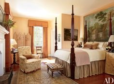 In another guest room, a large antique French gouache on paper is displayed at the head of a circa-1830 mahogany four-poster; the bedding is by Leontine Linens, and the throw is made of a Chelsea Editions check.