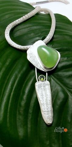 Cuttlefish cast sterling silver pendant set with green chrysoprase and peridot.