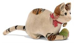 A STEIFF VELVET CAT WITH POM-POM, (2412), lying, painted striped spots, black button eyes, pink stitching, whiskers, ribbon with bell and FF button, circa 1908 --4½in. (11cm.) long