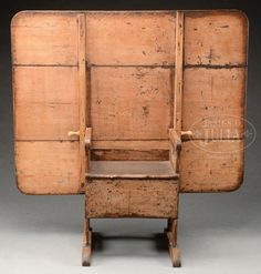 """EARLY AMERICAN SHOEFOOT HUTCH TABLE IN SALMON PAINT.Late 18th early 19th century, New England. The rectangular three board top with rounded corners hinged to the chair base by wooden belaying pins passing through the horizontal arms with rolled grips centering single plank seat with pinned molded edge flanked by plank supports with crescent ends at arms and shoefoot base. SIZE: 52"""" h (open) x 53"""" w x 23-1/2"""" d. 27-1/2"""" h (table top) x 53"""" l x 42"""""""