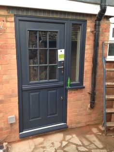 Anthracite grey Solidor Stable door with flag window fitted in Sandy by Rock Solid Doors Cedar Garage Door, White Garage Doors, Single Garage Door, Garage Door Paint, Grey Front Doors, Garage Door Makeover, Garage Door Design, Solid Doors, Anthracite Grey Windows