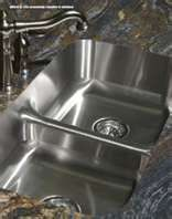 Stainless Steel sink with a Formica countertop.