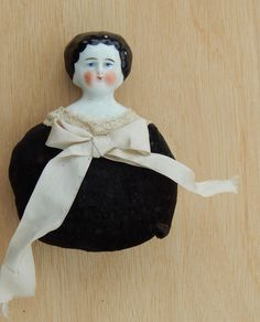 SOLD Antique china head doll pincushion. Now available in my Ruby Lane store: Kim's Doll Gems