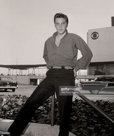 American singer and musician Elvis Presley (1935 - 1977) poses outside CBS Television City, Los Angeles, California. 1956. The was the year of Presley's landmark performance on the Ed Sullivan show, which was recorded at this studio on September 9, 1956.