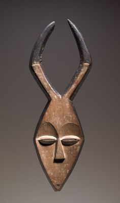 Africa | Kwele peoples, Gabon | Early 20th century | Wood, pigment