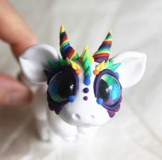 The detail around the eyes and the use of the rainbow accents as the only pops of color on an otherwise neutral pallet. Besides the fact that it's adorable, I love the use of technique.