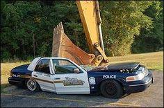 cop car recked - pigsarefunny.com
