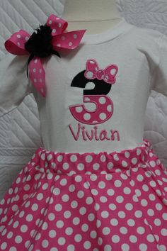 This is the perfect birthday outfit for your little Minnie Mouse lover.  Perfect to wear for her special day or for a birthday trip to Disney.  Please put your child's name in the notes section of your order if you would like this to be personalized.  The skirt is very full, it is a twirl skirt with an elastic waist.  The shirt can be made in long sleeve or short sleeves.  This can also be made in red and white polka dot if you would like that instead.  I also sell Minnie Mouse headbands in…