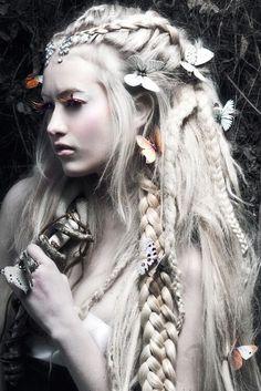 Platinum blonde with braids and butterflies. Fashion