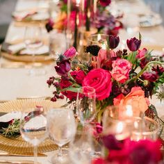Nashville wedding planner Sage Nines created this luxury wedding tablescape with bright florals, gold chargers and custom geometric menus