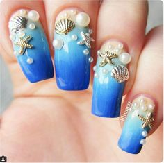 "If you're unfamiliar with nail trends and you hear the words ""coffin nails,"" what comes to mind? It's not nails with coffins drawn on them. It's long nails with a square tip, and the look has. 3d Nail Art, Ocean Nail Art, Trendy Nail Art, Cute Nail Art, Stylish Nails, Sea Nails, Blue Nails, Bright Nails, Mermaid Nail Art"