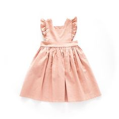 Our signature pinafore in a pale pink linen. 3 wooden button closure down the back. Sizing is tts. If you want a shorter above knee look size down.  Laundry Instructions Gentle cycle with like colors and hang dry. Iron if preferred.