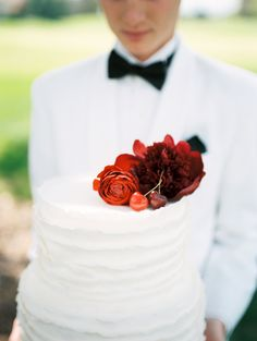 Red Flowers on Wedding Cake | photography by http://www.defiorephotography.com/