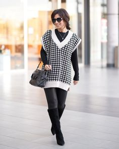 An all black outfit ensemble layered with an oversized knit vest | For more style inspiration visit 40plusstyle.com