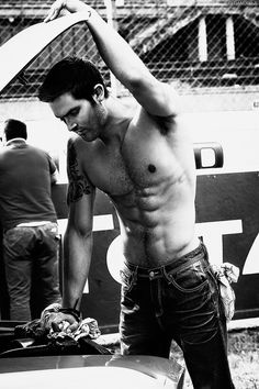 Tyler Hoechlin. I always thought he was a hottie. Now he is standing over a vehicle shirtless. Oh my god.