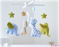 Elephant & Giraffe baby mobile - crib mobile - blue, green, beige and white - stars and moon nursery mobile - MADE TO ORDER by LullabyMobiles on Etsy https://www.etsy.com/listing/191605559/elephant-giraffe-baby-mobile-crib-mobile