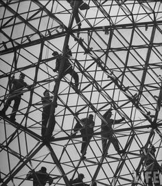 Building the geodesic dome added to the Ford Rotunda in Dearborne, Michigan in 1953.  TC Howard designed the dome for Buckminster Fuller.
