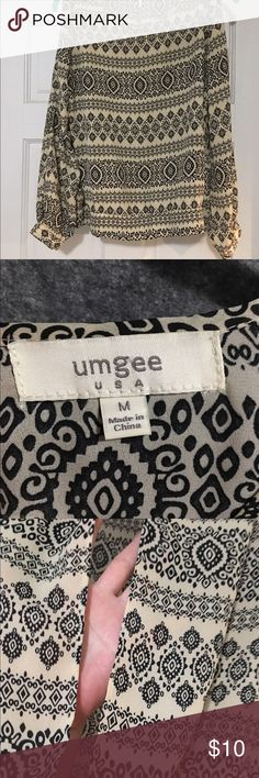 Umgee tribal peek-a-boo shirt size Medium This is great!!! Has peek-a-boo slits in the sleeves and up the back. Too cute!!! We are cleaning out closets and have many designer items to find a new home for!!! BUNDLE!!!!  Priced to sell!!! Umgee Tops Blouses