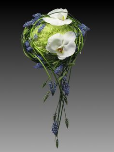 Unique carnation, orchid, and muscari cascade bouquet. Proof that you can combine inexpensive blooms (carnations) and expensive blooms (orchids and muscari) together for a cohesive and beautiful bouquet or arrangement.