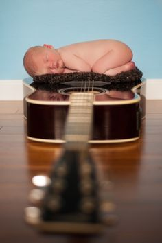 newborn boy on guitar with blue wall -Tavia Larson Photography, Harrisburg PA - in home newborn photographer