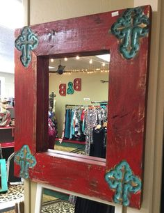 Rustic red mirror with turquoise crosses