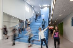 The Vibeeng School / Arkitema Architects, forum, hall, stair, kids, staggered acoustical ceiling tile