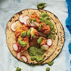 Fried Chicken Tacos with Buttermilk-Jalapeño Sauce | Use this creamy sauce to dress up store-bought fried chicken or as a salad dressing or dip for wings. Adjust the heat by adding more or less jalapeño. We like to double up on the tortillas, taco-truck style, for any of these tacos.