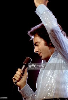 Singer Neil Diamond performs onstage wearing a sequin shirt in circa 1977 in Los Angeles, California. Neal Diamond, Diamond Girl, Diamond Music, Stock Pictures, Stock Photos, The Jazz Singer, Sequin Shirt, Famous Singers, Perfect Man