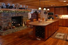 KSM Log Homes Photo Gallery...Gorgeous double-sided rock fireplace in kitchen and family room.
