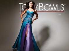 Strapless charmeuse prom dress with asymmetrical pleating on bodice with embroidered and beaded accents, looped treatment at side waist and a-line skirt with contrast color inner skirt. Removable straps and matching shawl included.Sizes 0 - 16