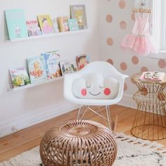 The chair the gold polka dot walls book corner and little lamp. Super cute