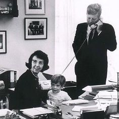 President Kennedy with his personal secretary Ms. Evelyn Lincoln and his son JFK jr.
