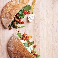 With flavors reminiscent of a falafel, Fried Chickpea and Arugula Pita Sandwiches with Lime Tzatziki take less work, are tasty with lots of texture, and an easy weeknight meal to put together.   MyRecipes