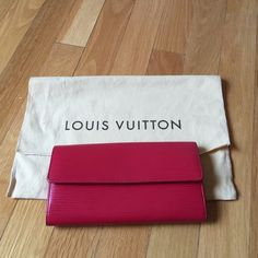LV red Epi wallet Excellent condition. Used only a few times. Guaranteed authentic. Comes with dustbag. Couldn't get a really good pic of the date code cuz it's inside the zippered area. Sold as is. All sales are final. Louis Vuitton Bags Wallets
