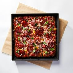 The former Manhattan chef and pizzaiolo has launched Black Seed Pizza, Sicilian-style pan pizzas fired in a wood oven usually used for bagels.