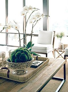 Orchid and moss ball on thecoffee table