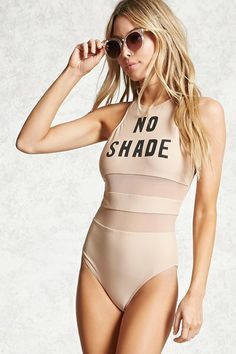 """A stretch-knit one-piece swimsuit featuring a """"No Shade"""" graphic, a halter neckline with slide-lock closure, a racerback, and mesh panels."""