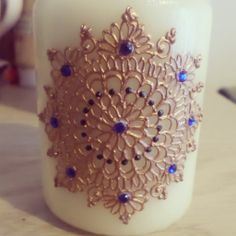 henna inspired candle designed by me in gold with blue gems :)